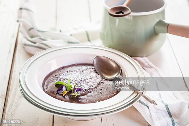 Plate of chocolate pudding decorated with edible flowers