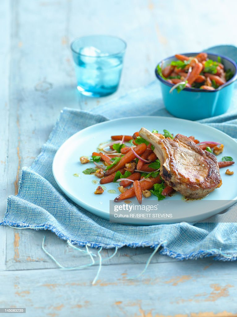 Plate of chops with vegetables : Stock Photo