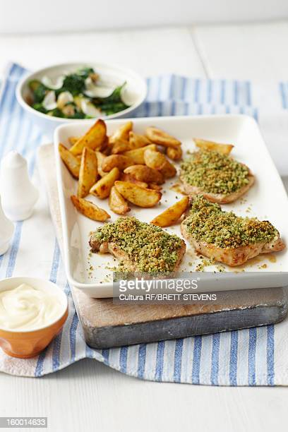Plate of crusted pork and potatoes