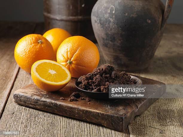 Plate of dark sugar and oranges