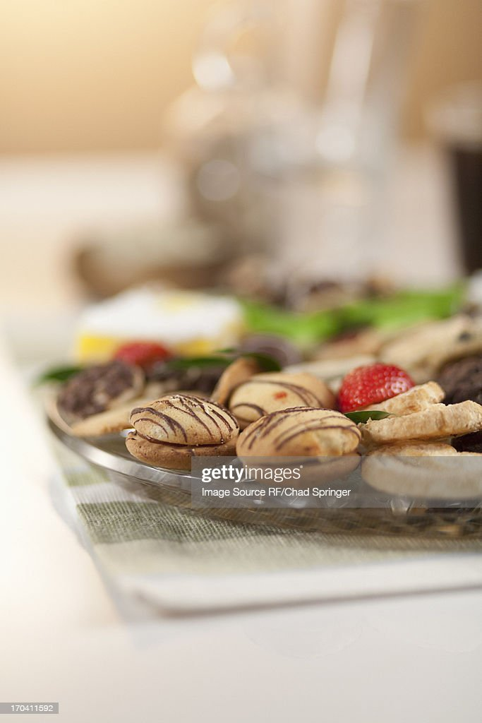 Plate of decorated cookies on table : Stock Photo