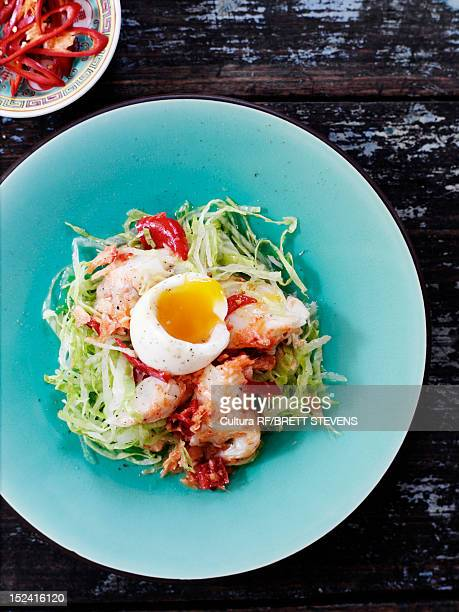 Plate of egg, meat and salad