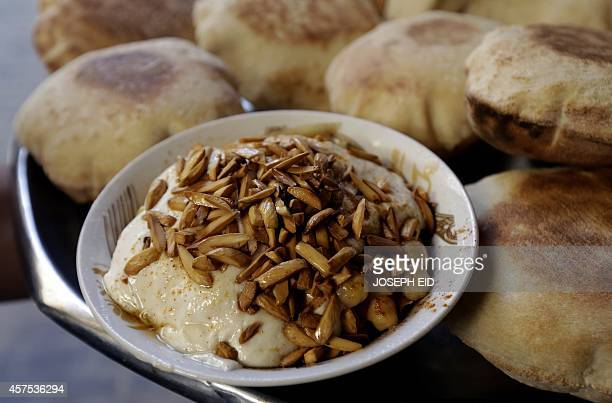 A plate of Fatteh is served at a restaurant in the Lebanese coastal city of Tripoli north of Beirut on October 20 2014 Fatteh is a dish that uses...