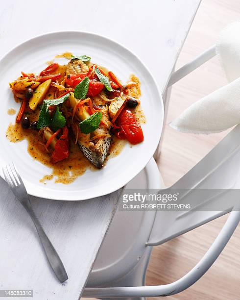 Plate of fish tagine with tomato