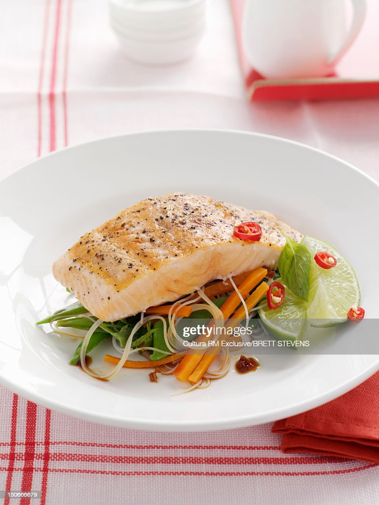 Plate of fish with vegetables : Stock Photo