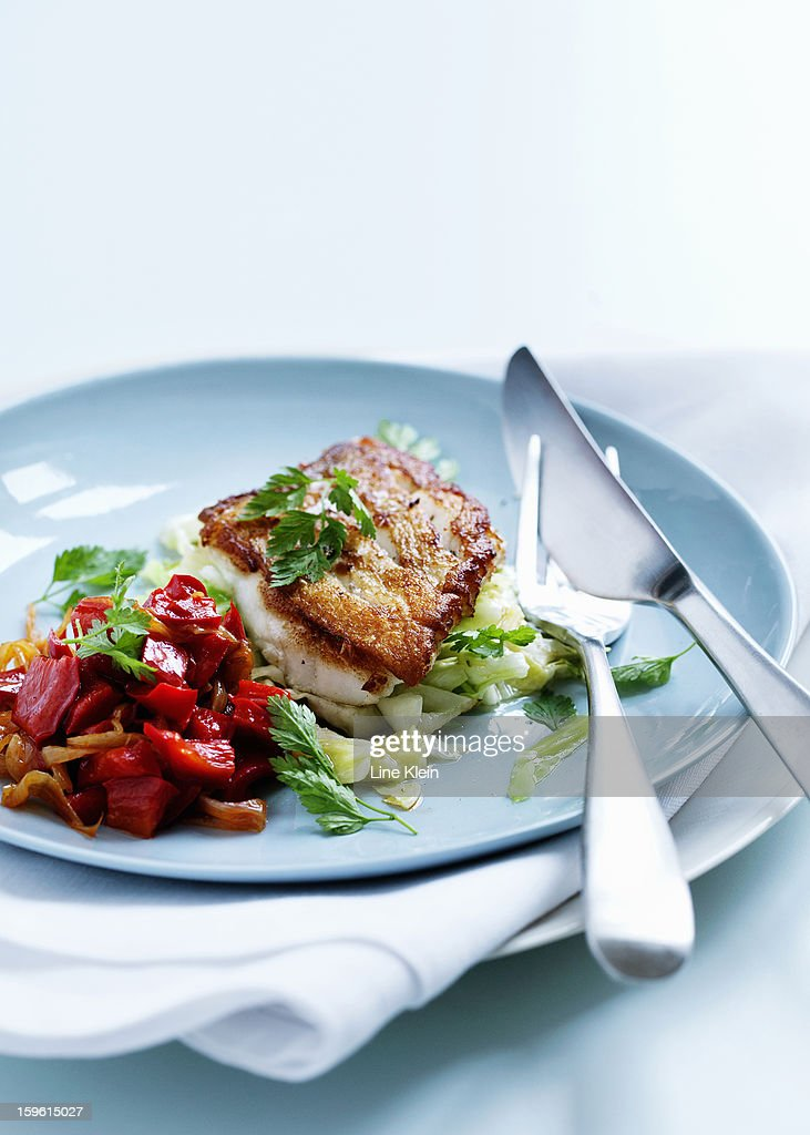 Plate of fried fish and salad : Stock Photo