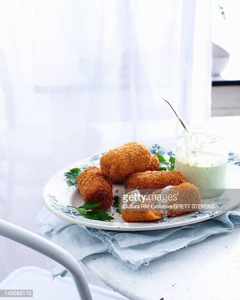 Plate of fried salmon with yogurt