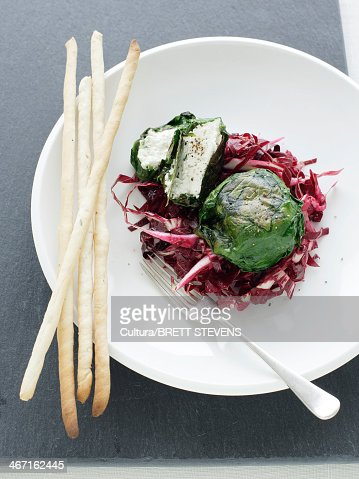 Plate of goat cheese with salad