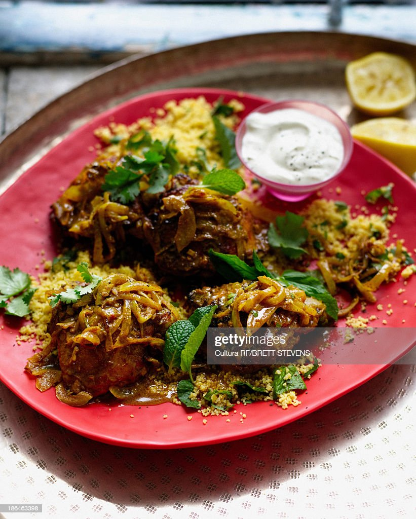 Plate of harissa chicken with couscous and mint yogurt : Stock Photo