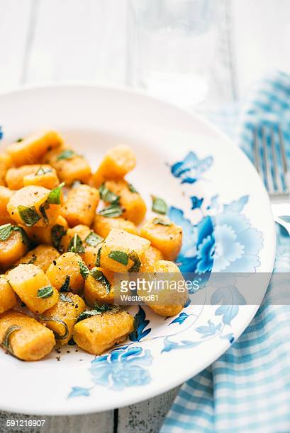 Plate of homemade pumpkin gnocchi with sage