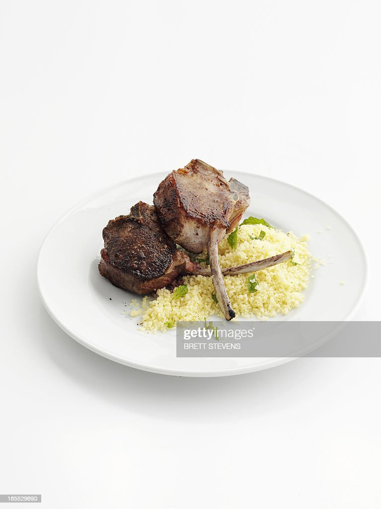 Plate of lamb cutlet with couscous : Stock Photo
