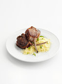 Plate of lamb cutlet with couscous
