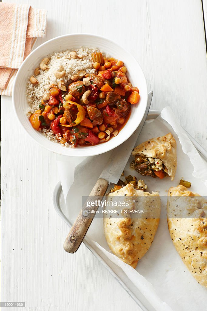 Plate of lamb tagine with baked pastries : Stock Photo