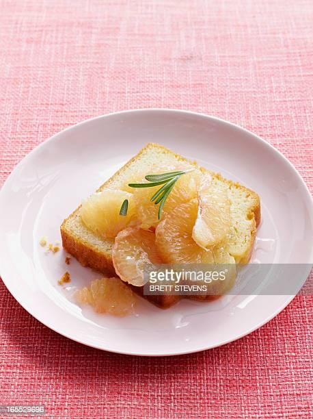 Plate of lemon cake with grapefruit