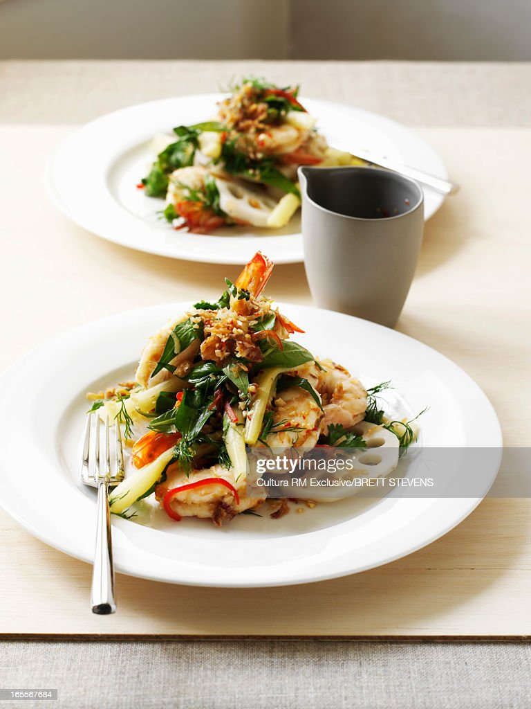 Plate of lotus root and prawn salad : Stock Photo