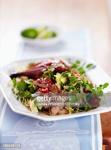 Plate of meat and salad : Stock Photo