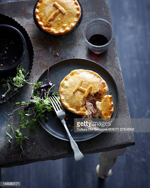 Plate of meat pie with herbs