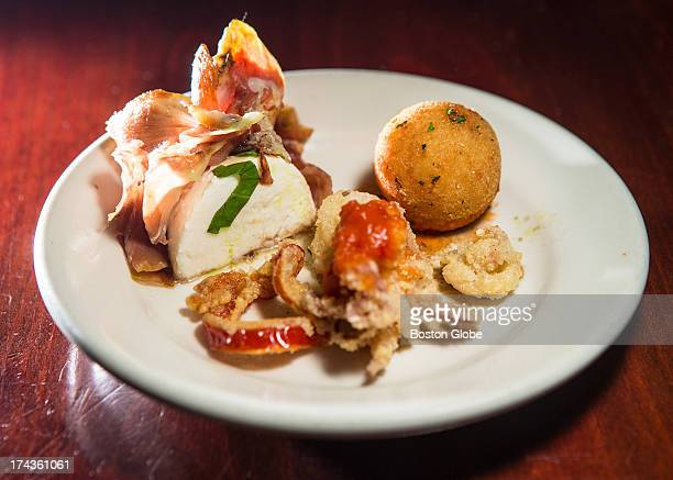 A plate of mozzarella and prosciutto crispy garlic calamari and arancini at Bacco Ristorante in Boston served to participants during a Dishcrawl...