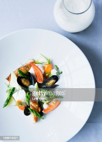 Plate of mussels with salad : Stock Photo