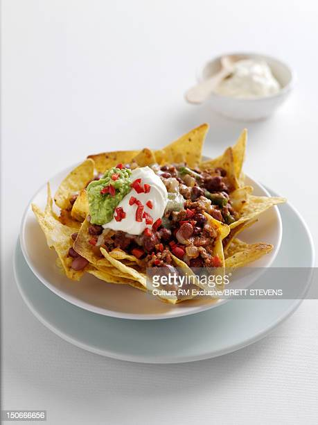 Plate of nachos with sour cream
