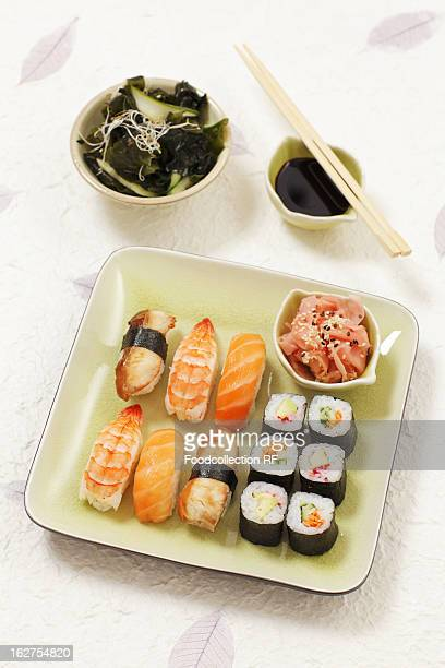Plate of nigiri sushi and hosomaki sushi