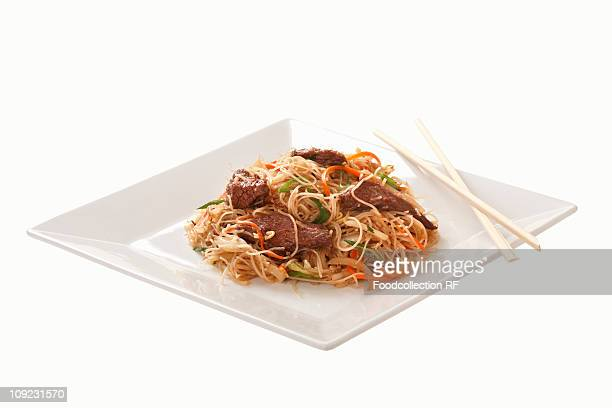 Plate of noodles with beef, close-up