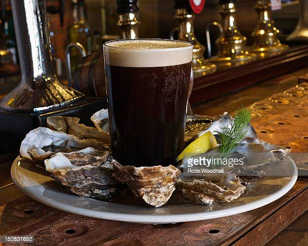 Plate of oysters and stout in bar