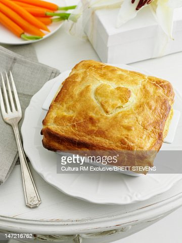 Plate of pie with decorative heart : Stock Photo