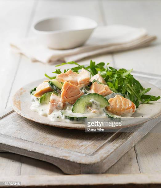 Plate of poached salmon with salad