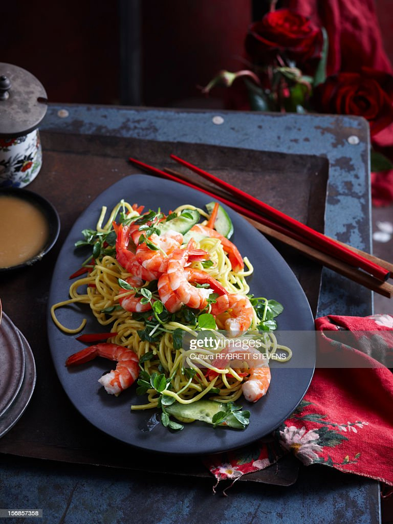Plate of prawns and noodles : Stock Photo