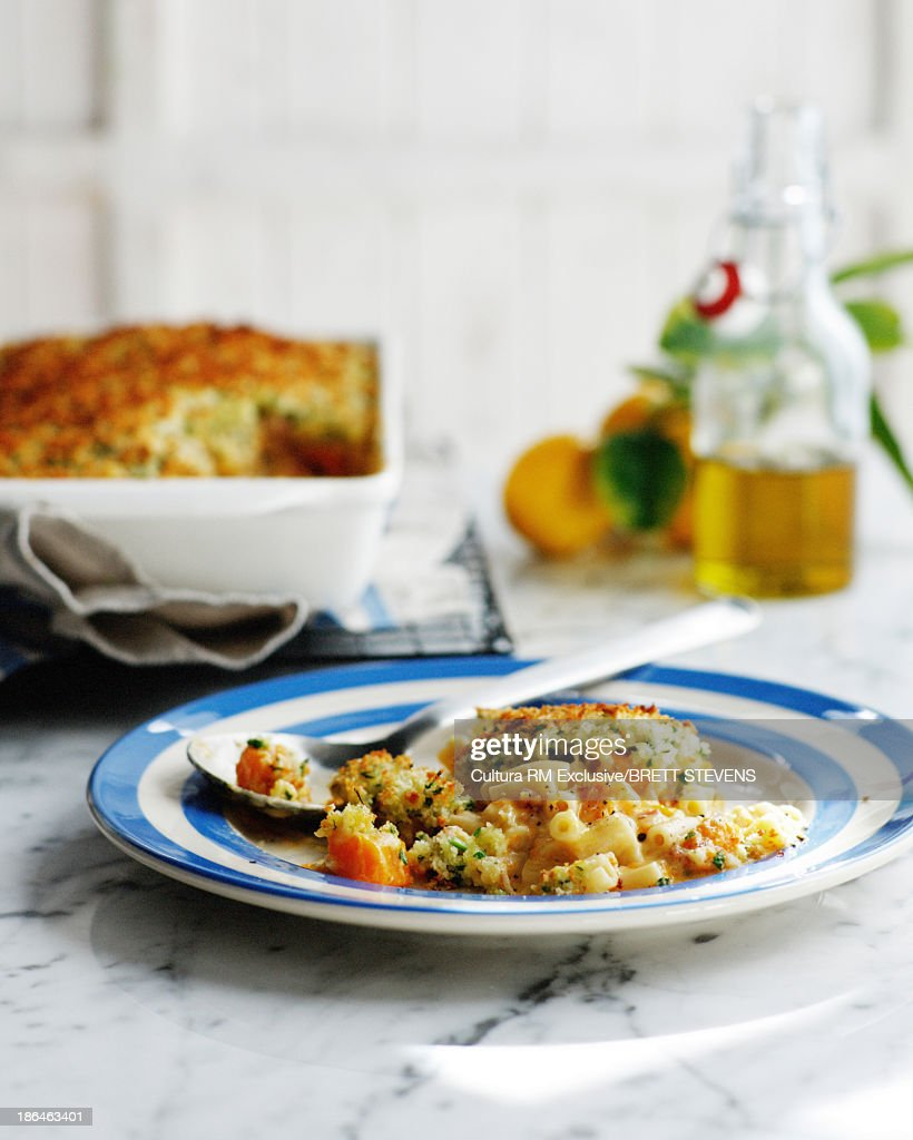 Plate of pumpkin pasta bake with breadcrumbs : Stock Photo
