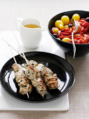Plate of quail kebabs with vegetables