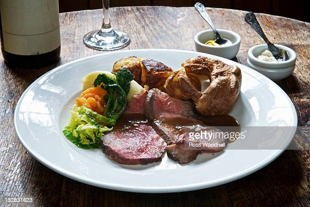 Plate of roast beef with vegetables