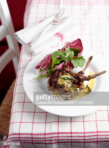 Plate of roast chops and herbs : Stock Photo