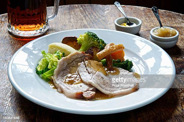 Plate of roast pork with vegetables