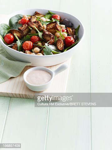 Plate of roasted eggplant and salad : Stock Photo