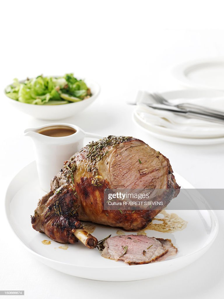 Plate of roasted lamb : Stock Photo