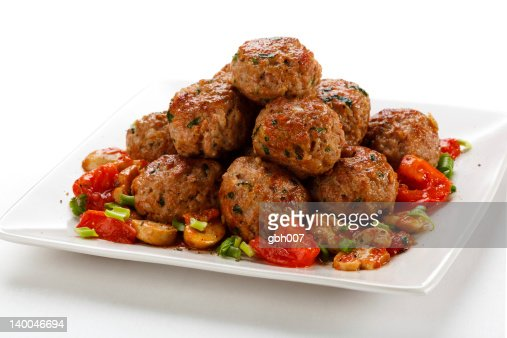 Plate of roasted meatballs on white surface : Stock Photo