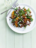 Plate of roasted pumpkin with salad