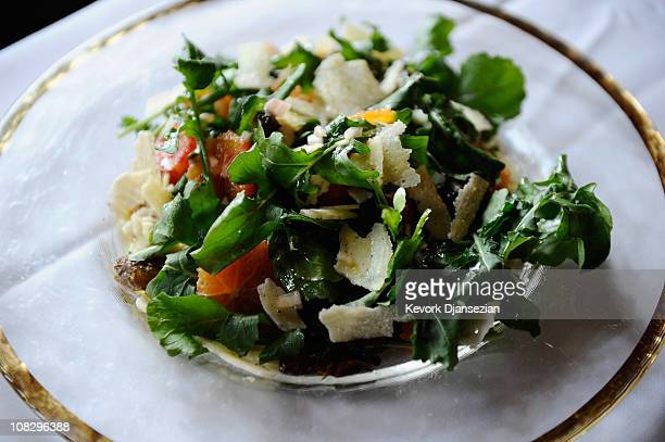 A plate of salad with blood oranges dates arugula and parmesan chees prepared by Lucques chef Suzanne Goin is on display during food and wine event...