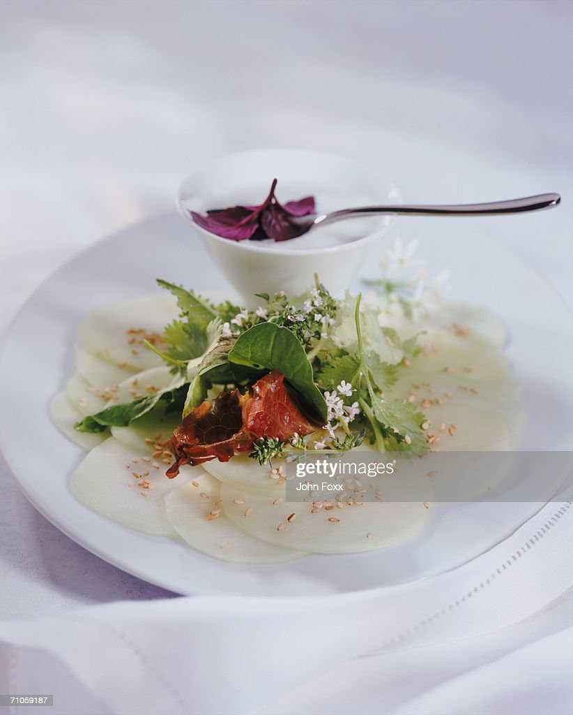 Plate of salad with bowl and spoon : Stock Photo