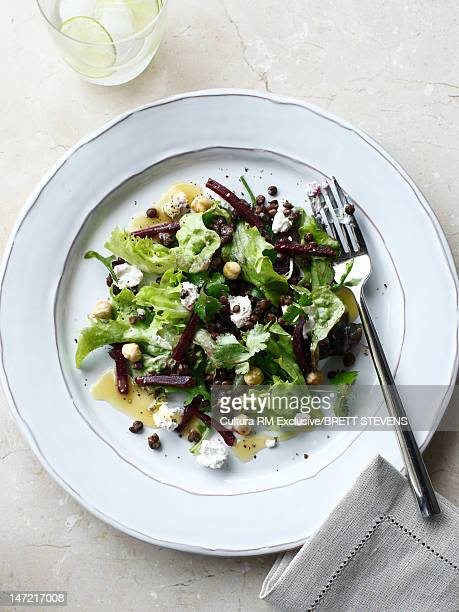 Plate of salad with cheese and lettuce