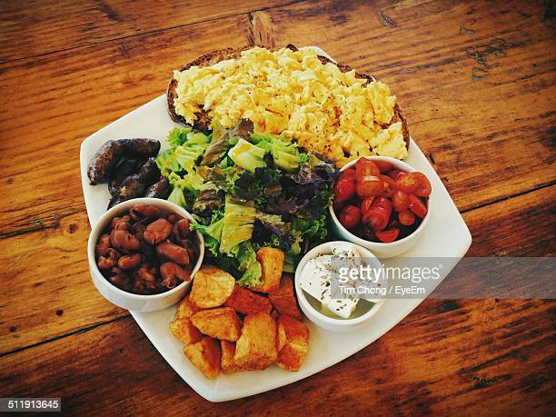 Plate of salad with roasted potatoes