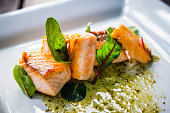 Close up of Plate of salmon and arugula. Fresh and bright look