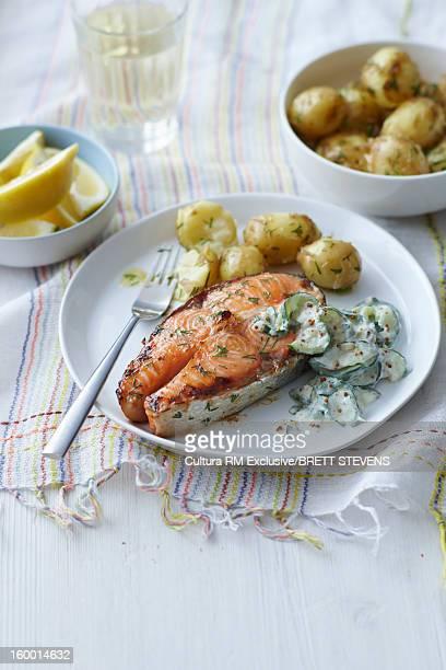 Plate of salmon, potatoes and salad