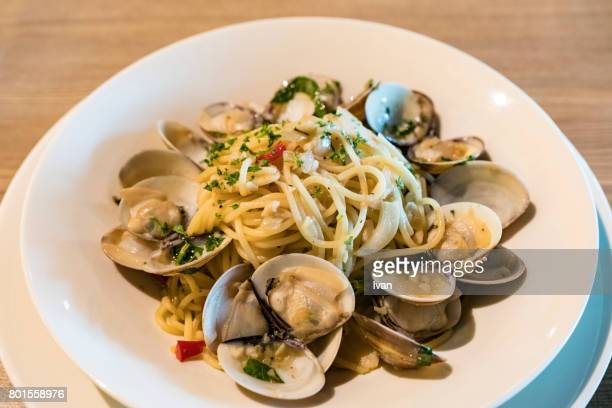 Plate of Seafood Spaghetti Vongole Cooked with White Wine, view from above