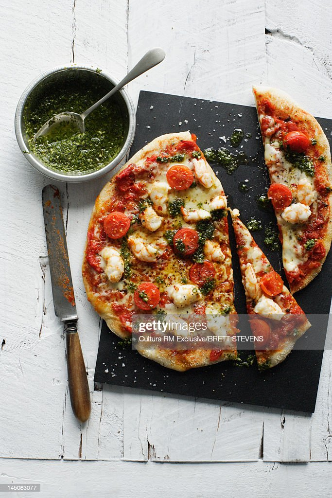Plate of shrimp and tomato pizza