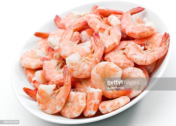 Plate of shrimps on white background