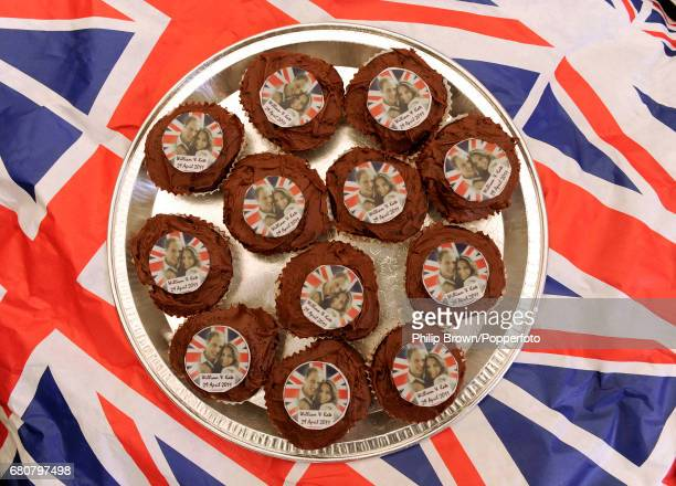 A plate of small cakes decorated with photographs of the newlyweds on display at a gathering in Bucklebury near Reading on the day that Kate...
