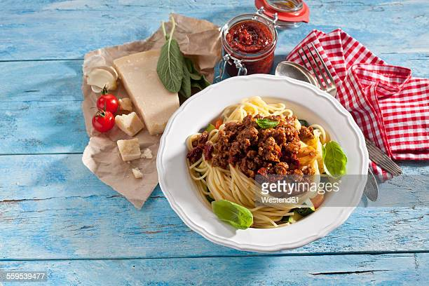 Plate of Spaghetti Bolgnese and ingredients